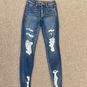 American Eagle super high rise ripped jeans